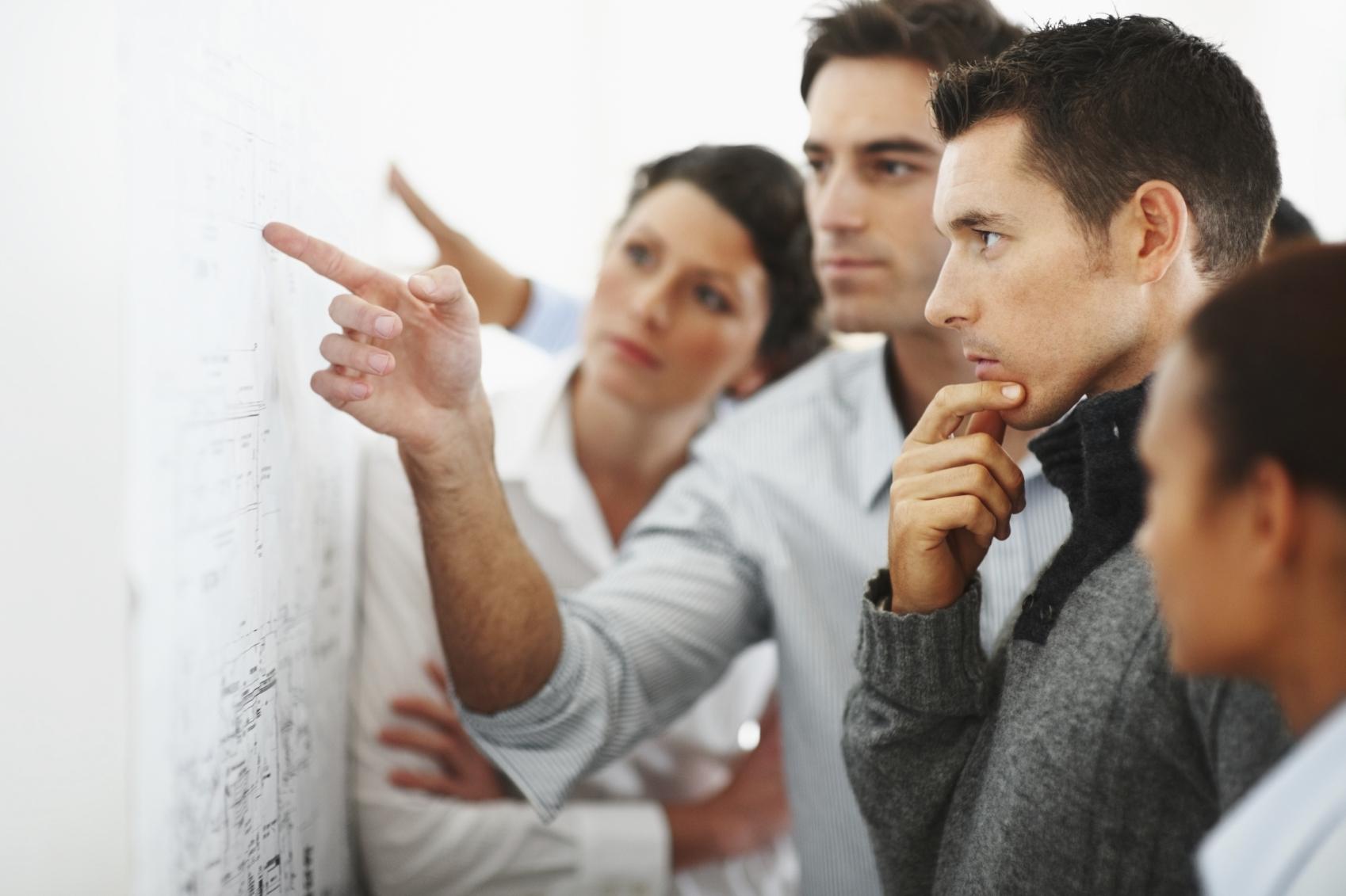 executives_team_working_whiteboard