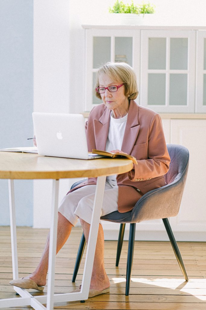 Older woman trying to find information on her computer