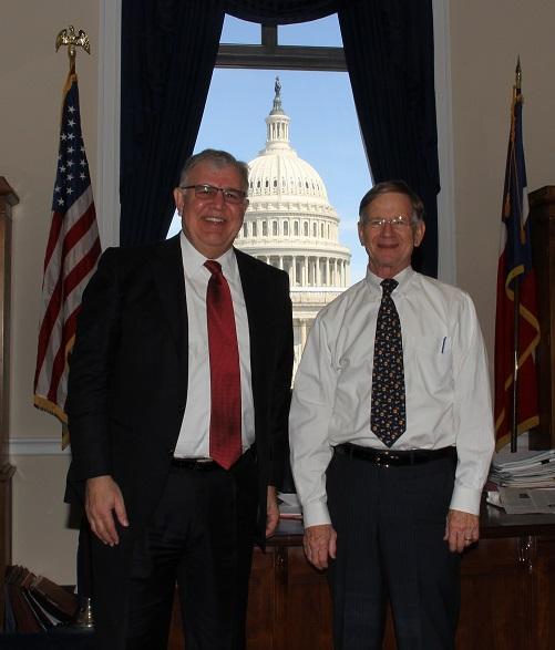 Gartner analyst Jorge Lopez, left, with U.S. Rep. Lamar Smith (R-TX).