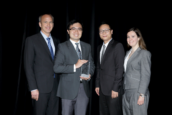 Winners of Gartner's Global Award for Best BPM Initiative, Charles Nie and Barry Cheung, collect their trophy from Gartner analysts Samantha Searle and Bruce Robertson